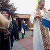 Record-Eagle/Jan-Michael Stump<br /> James Rehmann, left, smiles after his pony, Sarge, was blessed by Fr. Ken Stachnik, right, during the blessing of the animals outside St. Francis Catholic Church in celebration of the Feast of St. Francis of Assisi, the patron saint of animals. Rehmann brought Sarge with his parents, Steve and Sue, and his brothers, Levi, Luke and Jack.