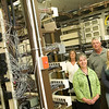 Record-Eagle/Jan-Michael Stump<br /> Peninsula Telephone Company employees, clockwise from top left, Cindy Dyer, Mary Jo Lance, Sue Bouchey and John DeVol stand surrounded by switches.