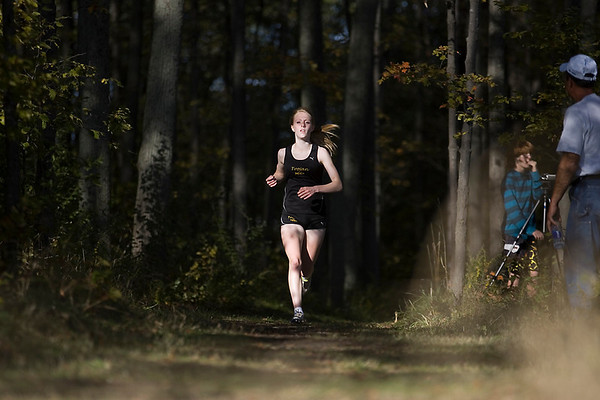 Record-Eagle/Keith King<br /> Traverse City Central's Miranda Belcher runs alone Tuesday during the Big North Conference cross country meet.