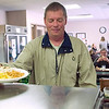 Record-Eagle/Jan-Michael Stump<br /> Michael Edmonds gets lunch at The Goodwill Inn in Traverse City on Friday afternoon. The Inn is one of the places that uses food from Food Rescue to helps its residents.