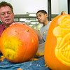 "Record-Eagle/Jan-Michael Stump<br /> Old Mission Peninsula School second-grader Shawn Trujillo watches as Pat Harrison, the ""Lord of the Gourd,"" demonstrates his pumpkin carving skills. Harrison said he typically will carve over 400 pumpkins a season for places like schools and farms, but will only see a couple actually lit up."