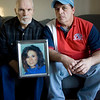 Record-Eagle/Keith King<br /> Lyle Sutton, left, and Tedd Strieter, both of Traverse City, sit with a photo of their sister, Shari Marvin, on Wednesday.