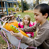 "Record-Eagle/Keith King<br /> Tony Anthony, 9, and Carina Ingersoll, 5, both of Traverse City, insert plastic hands while  decorating a pumpkin Monday after using leaves for hair. ""It's a pumpkin person that has no legs,"" Tony said."