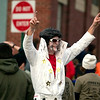 Record-Eagle/Jan-Michael Stump<br /> Dressed as Elvis, Doug Spence celebrates his finish in the Zombie Run 5K Saturday morning in Traverse City.