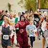 Record-Eagle/Jan-Michael Stump<br /> Runners take off at the start of Saturday morning's Zombie Run 5K in Traverse City.
