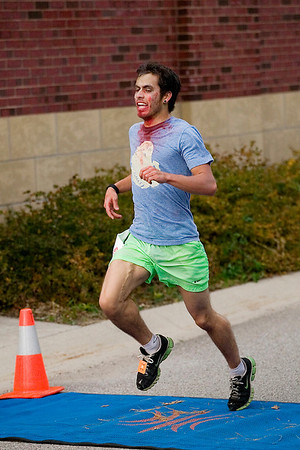 Record-Eagle/Jan-Michael Stump<br /> Topher Fast was the first across the line and first overall at 17:52.1 in the Zombie Run 5K.