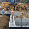 Record-Eagle/Keith King<br /> Mark Fedorinchik, a superintendent with Hallmark Construction Inc., backfills at the foundation to prepare for floor slabs at the future site of a Grand Traverse County Sheriff's Department storage facility at Hammond Commerce Centre.