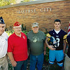 Record-Eagle/Keith King<br /> From left, Jim Tompkins, Frank McManus and Owen Lada, all of Traverse City, stand with TC Central High School students and football players Nick Bonaccini  and Brandon McKee.  Tompkins is a member of the Korean War Veterans Association while McManus and Lada are both United States Marine Corps veterans and were players on the Traverse City varsity football team in 1949. Bonaccini holds a Traverse City Central High School football helmet which has a camouflage-designed stripe on it. The helmet will be worn by Traverse City Central High School football players during their game against Gaylord High School on Friday during the Wounded Warrior football game at Thirlby Field.