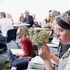 "Record-Eagle/Jan-Michael Stump<br /> Hannah Flaugher, of Traverse City, sniffs a bunch of yarrow during a ""Common Plant Knowledge"" class with Meg Louwsma on Friday at the 10th annual Great Lakes Bioneers Conference at Northwestern Michigan College."