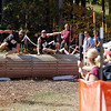 Record-Eagle/Jan-Michael Stump<br /> Geoffrey Brown (8) and Scott Robinson (89) leap a barrier on Mt. Holiday near the end of the three mile obstacle-filled course of Saturday's King of the Mountain race.