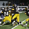 Record-Eagle/Keith King<br /> Traverse City Central defenders Dylan Kelly (24), Brandon McKee (obscured), Kevin Kelm (30) and Jordan Lutze (56) get a safety against Gaylord on Friday at Thirlby Field in Traverse City.