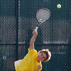 Record-Eagle/Jan-Michael Stump<br /> Traverse City Central's Fisher Sutherland serves during Tuesday's No. 1 singles match against Petoskey's Zack Phillips during Tuesday's Big North Championship at Traverse City West High School.