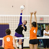 Record-Eagle/Keith King<br /> Leland's Elizabeth McKee spikes over Kingsley's Anne-Marie Sanchez.