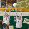 Record-Eagle/Keith King<br /> Traverse City West's Ressa Borkovich, left, and Katie Placek, right, jump to block a shot from Alpena's Nicole Ross Wednesday, October 12, 2011 at Traverse City West High School.