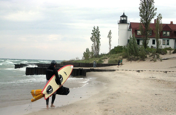 Record-Eagle/Jodee Taylor<br /> A kiteboarder makes his way back from surfing the waves on Lake Michigan at Point Betsie in Frankfort. The National Weather Service in Gaylord has issued a wind advisory, which is in effect from 8 a.m. until midnight. There's a possibility of gusts of up to 45 mph.