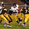 Record-Eagle/Douglas Tesner<br /> Gaylord's Trent Donker (17) is swarmed by Traverse City Central defenders, including Nick Bruning (4), Max Bollinger (60) and Mike Heim (7). TC Central defeated the Blue Devils, 36-20.