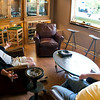 Record-Eagle/Douglas Tesner<br /> Dennis Tilley and Kurt Grockau relax in the new smoking lounge at Nolan's Tobacconists on Front Street. The popular downtown gathering spot expanded into an adjacent space to include the new lounge featuring custom furniture and large-screen TV, an expanded humidor and a small office.