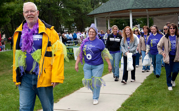 Record-Eagle/Douglas Tesner<br /> Dave Bugai leads his wife of 41 years, Linda, during the Alzheimer's Association Memory Walk in Traverse City. Dave suffers from dementia.