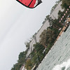 Record-Eagle/Douglas Tesner<br /> John Smith, of Traverse City, takes advantage of the windy weather and enjoys some kiteboarding on West Grand Traverse Bay.