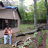 Record-Eagle/Art Bukowski<br /> Amanda Lennington, left, and Danielle Wegrecki stand outside the Peninsula Township home they rent. A large section of tree fell on the home, causing considerable damage.