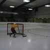 Record-Eagle/Jodee Taylor<br /> Thomas Barnes, 12, of Grayling, pushes the net into position before practice for his peewee hockey team at Howe Arena.