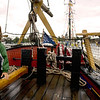 Record-Eagle/Keith King<br /> Arlo Knauf, 3, of Bellaire, stands next to the tiller of the Armed Sloop Welcome on Saturday during the Michigan Schooner Festival in Traverse City. A tiller is what is used to control the rudder.