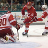 Record-Eagle/Jan-Michael Stump<br /> Pavel Datsyuk (13) tries to beat goalie Chris Osgood as Niklas Kronwall defends.