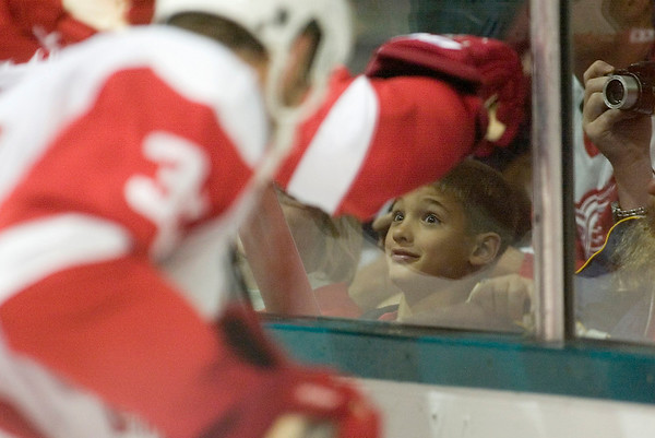 Record-Eagle/Jan-Michael Stump<br /> Cole Bartow, 9, of Gaylord, gets a close-up view of the Red Wings Red and White game Tuesday night at Centre ICE Arena. Tuesday was the Wings' last night in town for training camp; they open their season Oct. 2 in Stockholm, Sweden.