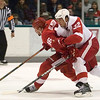 Record-Eagle/Jan-Michael Stump<br /> Red Wings forward Tomas Holmstrom (96) skates past defenseman Jonathan Ericsson (52) during Tuesday's Red and White game at Centre ICE Arena.