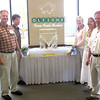 Record-Eagle/Bill O'Brien<br /> Members of the Oleson family gather around an ice sculpture of the long-time area grocery chain's logo during a reception and tribute dinner Tuesday night at the Hagerty Center in Traverse City. The Michigan Grocers Association honored Oleson's Food Stores for its 75th anniversary in the organization — its longest-serving member. Pictured from the left are Oleson's Vice President D.J. Oleson, who's also the MGA Board's vice-chairman, Mark Oleson, Linda Gobler, president and CEO of the grocers association, and family members Marty Watts and Brad Oleson. The event was part of the MGA's annual fall conference.