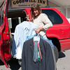 Record-Eagle/Douglas Tesner<br /> Ruth Blick, director of marketing and fund development for Goodwill Industries of Northern Michigan, brings some donated suits to the Goodwill Inn.
