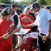 Record-Eagle/Dennis Chase<br /> Red Wings sign autographs in the parking lot.