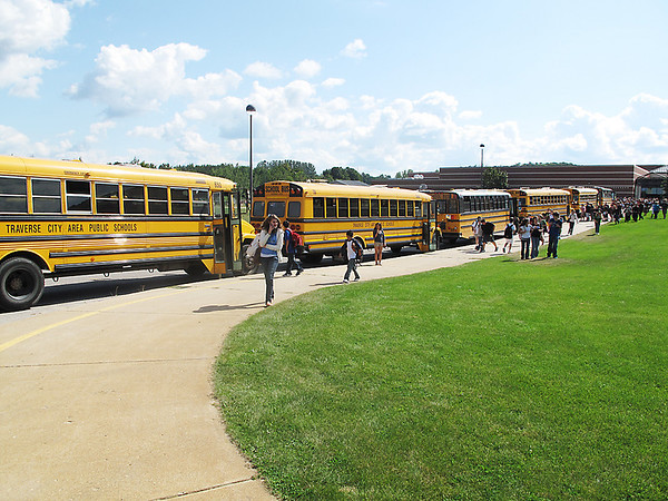 Record-Eagle/Lindsay VanHulle<br /> Buses line up at the end of the day at Traverse City East Middle School. A systems glitch caused about 200 students to be without an afternoon route when school started last week.