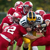Record-Eagle/Jan-Michael Stump<br /> Glen Lake's Nate Sneed (16) gets tackled by Suttons Bay's Layton Korson (22), Aiden Keilty (20), David Pasch (84) and Noah Reyhl (23) in the first quarter of Friday's game.