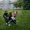 Record-Eagle/Keith King<br /> Sofia Molby, center, and Carlie Henderson, right, both age 6, are pulled back on a rope swing by 12-year-old Kameron Molby during a romp in their Traverse City neighborhood.