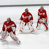 Record-Eagle/Jan-Michael Stump<br /> From left, Jimmy Howard, Ty Conklin and Thomas McCollum warm up before Saturday morning's skate. Howard and Conklin are today's Red-White game starters in goal.