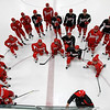 Record-Eagle/Jan-Michael Stump<br /> Players listen to a coach explain a drill as the Detroit Red Wings open training camp on Saturday morning at Centre ICE Arena in Traverse City.
