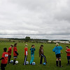 Record-Eagle/Keith King<br /> The Cougars warm up prior to their fifth- and sixth-grade league game with the Strikers on Thursday. The game was the first to be played at the Grand Traverse Bay YMCA Meijer Athletic Fields in Traverse City.