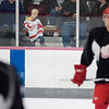 """Record-Eagle/Keith King<br /> Samuel Malloy, 3, of Brimley, watches from the stands Saturday during the Detroit Red Wings training camp at Centre ICE. """"We're hoping hockey is in his blood,"""" said his mother, Phyllis Malloy, of Samuel, who was adopted from near Moscow, Russia."""