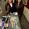 Record-Eagle/Keith King<br /> Jeanne Strathman, left, president of Advanced Hearing Center, P.C., and Betsy Ray, administrative assistant, stand near a collection of hearing aids that will be donated to people in Ethiopia.