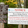 Record-Eagle/Jan-Michael Stump<br /> A sign near a trailhead warns hikers of potentially hazardous newly exposed land as Brown Bridge Pond begins to draw down.