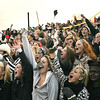 Record-Eagle/Keith King<br /> The Traverse City Central student section cheers on the Trojans during Friday's game.