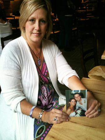 Record-Eagle/Jodee Taylor<br /> Linda Francombe, of Traverse City, holds a picture of her daughter, Heather Spencer, and her son, Xan Spencer. Heather Spencer was killed by her boyfriend in 2007 and Francombe has become an advocate for awareness of domestic violence.