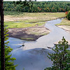 Record-Eagle/Jan-Michael Stump<br /> Brown Bridge Pond begins to show the effects of a drawdown that began earlier this week, part of the process that will result in the removal of Brown Bridge, Boardman and Sabin dams. Brown Bridge Dam, the farthest upstream of the dams, should complete its drawdown in a few months, with deconstuction beginning in the spring. Officials plan to remove Sabin Dam after Brown Bridge.