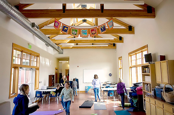 Record-Eagle/Keith King<br /> Students walk through the Greenspire School at The Village at Grand Traverse Commons complex.