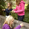 Record-Eagle/Keith King<br /> Belle Payette, bottom, 11, reshapes a stone while Emily Falconer, 11, top right, and Anna Clifton, 10, form vegetation at the Greenspire School.
