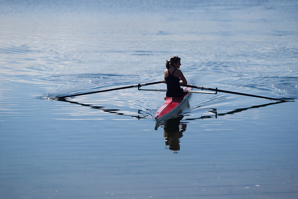 Record-Eagle/Jan-Michael Stump<br /> Melissa Fournier rows across Boardman Lake.