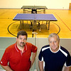 Record-Eagle/Keith King<br /> Dave Wilson, left, of Central Lake, and Mike Ratliff, of the Northern Michigan Table Tennis Club, stand in the gym of the closed Bertha Vos Elementary School.