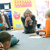 Record-Eagle/Jan-Michael Stump<br /> Traverse City Cooperative Preschool teacher Nancy Render watches Emmet Payette try to balance an egg. The school is celebrating its 40th anniversary.