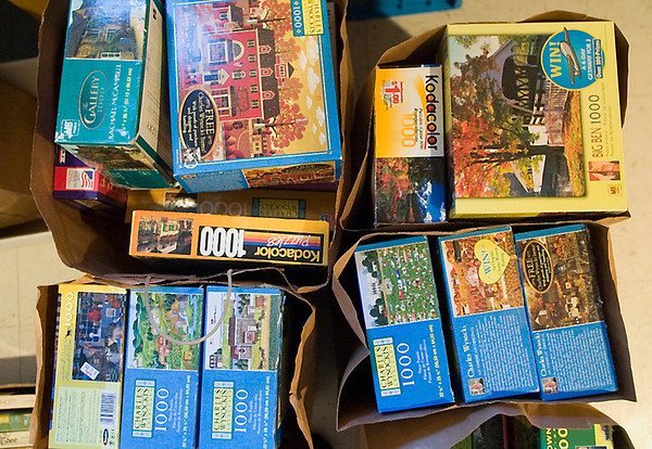 "Record-Eagle/Jan-Michael Stump<br /> Area families donate their old puzzles and buy ""new"" ones for a fraction of the cost.."